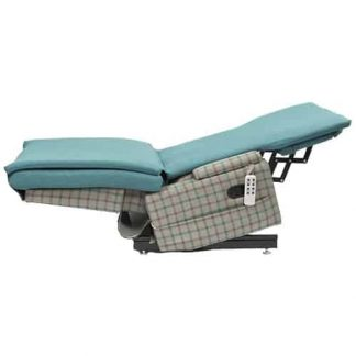Light blue and chequered chair bed, fully tilted and fully reclined into the trendelenburg position. Attached to the side is the remote control for the features.