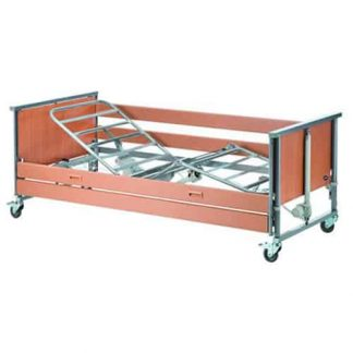 Invacare profiling bed facing the side with head boards, foot boards and a single side rail attached. There is no mattress but the silver frame has a slight raise.