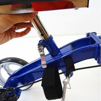 Blue and silver aluminium knee walker with a twist tab underneath the knee pad for height adjusting.