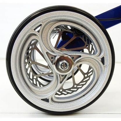 Wheel for the deluxe aluminium knee walker with three teardrop cut outs and silver disk brake behind.