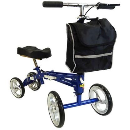 Front angled view of the blue and black deluxe knee walker, showing the knee padding, the four wheels, handle brakes and the shopping bag on the front. .