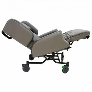 Side view of the care chair when tilted and recline, the grey back/arm rests are raised and the leg rest is reclined fully whereas the backrest is not.
