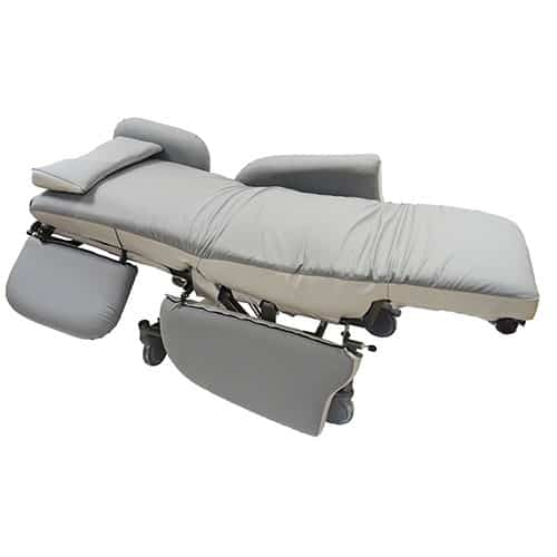 Light and dark grey lay-flat porter chair completely reclined into the lay flat position with half of the arm/back rests lowered showing transfer access.